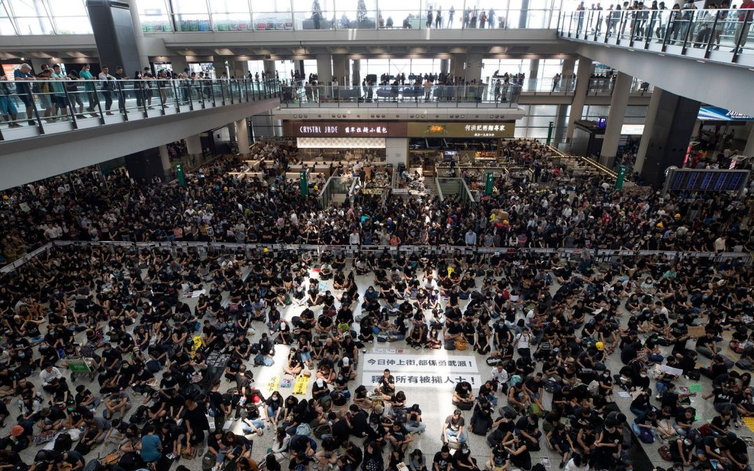 Hong Kong Airport Cancels Flights As Thousands Of Protesters Crowd Terminal